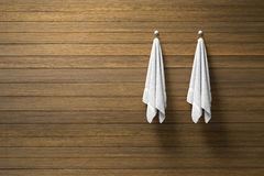 3D rendering : illustration of two piece of clean and white towel hanging on a wooden wall,light and shadow,copy space. 3d rendering,dark edges stock illustration