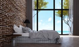 The loft bedroom interior design and brick wall pattern background and sea view. 3d rendering interior design of bedroom Stock Photography