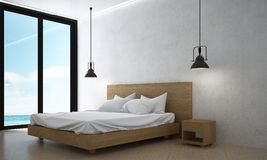 The interiors design idea of loft bedroom and concrete wall and sea view. 3d rendering interior design concept idea of bedroom Stock Photography