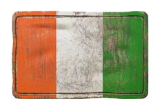 Old Ivory Coast flag. 3d rendering of a Ivory Coast flag over a rusty metallic plate. Isolated on white background Stock Image