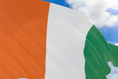 3D rendering of Ivory Coast flag waving on blue sky Royalty Free Stock Photography