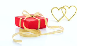 3d rendering joined hearts and a gift on white background. 3d rendering golden joined hearts and a gift on white background Royalty Free Stock Photo