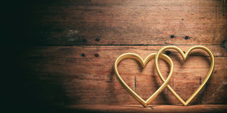 3d rendering joined hearts on wooden background Royalty Free Stock Image