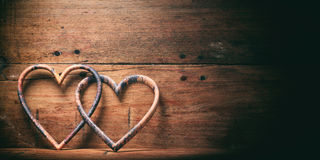 3d rendering joined hearts on wooden background Royalty Free Stock Photography