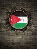 Old Jordan flag in brick wall. 3d rendering of a Jordan flag over a rusty metallic plate embedded on an old brick wall Stock Photos