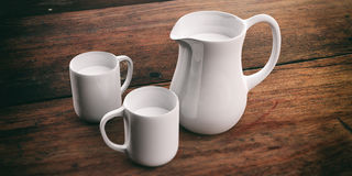 3d rendering jug and cups with milk. On wooden background Royalty Free Stock Photos