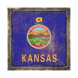 Old Kansas flag. 3d rendering of a Kansas State flag over a rusty metallic plate wit a rusty frame. Isolated on white background Stock Image