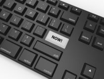 Keyboard with a highlighted button saying Now! royalty free illustration