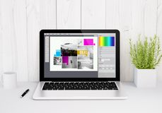 laptop on table graphic design software royalty free stock photo