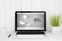 laptop on table cool and responsive website interior design Stock Image