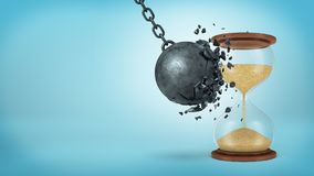 3d rendering of a large black iron wrecking ball breaks when collides with a retro hourglass on blue background. Royalty Free Stock Images