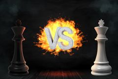 3d rendering of large black and white chess kings stand with flaming VS letters between them. Mind games. Business and strategy. Important choice Royalty Free Stock Photo