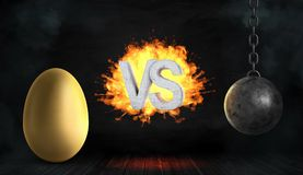 3d rendering of a large concrete letters VS on fire stand between a large golden egg and a black iron wrecking ball. Golden goose. Profitable business. Risk Stock Image