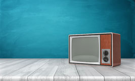 3d rendering of a large old-style CRT TV set in a brown frame standing on a wooden desk. Old TV shows. Retro appliances. Old technologies Royalty Free Stock Photos