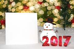 3D Rendering : 2017 light bokeh number and white card on perspective snowscape.snow man with sparkling bokeh wall light. And christmas tree in background.space Royalty Free Stock Image