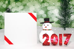 3D Rendering : 2017 light bokeh number and white card with red ribbon on perspective snowscape.snow man with sparkling bokeh wall Royalty Free Stock Image