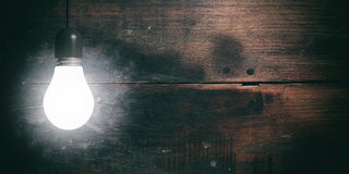 3d rendering light bulb on wooden background Stock Images