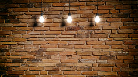 3d rendering light bulbs on brick wall background Stock Images