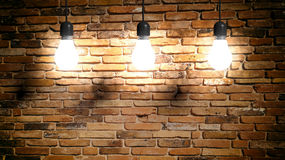 3d rendering light bulbs on brick wall background Royalty Free Stock Images