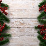 3D rendering light christmas wooden background. With branches of fir and holly berries Stock Images