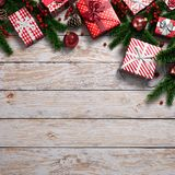 3D rendering light christmas wooden background. With branches of spruce, holly berries, ornaments and gifts Royalty Free Stock Photo