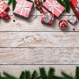 3D rendering light christmas wooden background. With branches of spruce, holly berries, ornaments and gifts Royalty Free Stock Photos
