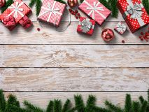 3D rendering light christmas wooden background. With branches of spruce, holly berries, ornaments and gifts Stock Photography
