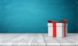 3d rendering of a lone white gift box with a red bow standing on a wooden desk in front of a blue background. Gifts and surprises. Special bonus. One time Stock Photography