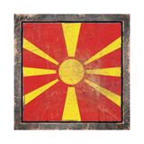 Old Macedonia flag. 3d rendering of a Macedonia flag over a rusty metallic plate wit a rusty frame. Isolated on white background Stock Images