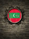 Old Maldives flag in brick wall. 3d rendering of a Maldives flag over a rusty metallic plate embedded on an old brick wall Royalty Free Stock Photos
