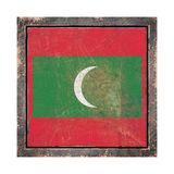 Old Maldives flag. 3d rendering of a Maldives flag over a rusty metallic plate wit a rusty frame. Isolated on white background Stock Photography