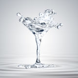 3D rendering of the martini glass with water drops Stock Photos
