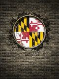 Old Maryland flag in brick wall. 3d rendering of a Maryland State flag over a rusty metallic plate embedded on an old brick wall Stock Photo