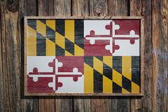 Wooden Maryland flag. 3d rendering of a Maryland State USA flag on a wooden frame and a wood wall Royalty Free Stock Photography