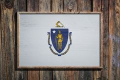 Wooden Massachusetts flag. 3d rendering of a Massachusetts State USA flag on a wooden frame and a wood wall Royalty Free Stock Photos