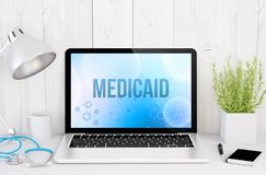 Medical desktop computer with medicaid on screen. 3d rendering of medical desktop with medicaid on screen Stock Photography