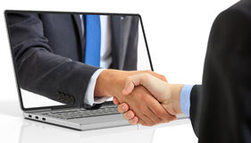 3d rendering men shaking hands through a laptop screen. On white background Royalty Free Stock Images