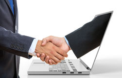 3d rendering men shaking hands through a laptop screen. On white background Stock Image