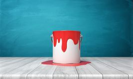 3d rendering of a metal bucket with red paint overflowing on its sides and on a wooden desk around it. Royalty Free Stock Images