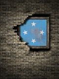 Old Micronesia flag in brick wall. 3d rendering of a Micronesia flag over a rusty metallic plate embedded on an old brick wall Stock Images