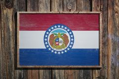 Wooden Missouri flag. 3d rendering of a Missouri State USA flag on a wooden frame and a wood wall Stock Photography