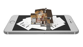 3D rendering of a modern house with smartphone and blueprint. A conceptual image of a modern cottage with smartphone and blueprint, three-dimensional models Stock Image
