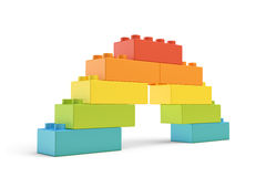 3d rendering of multi-colored toy blocks making up a rainbow bridge. Building sets. Children toys. Leisure and recreation Stock Image