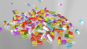 3D rendering multicolored medical pills. Falling from top to bottom Stock Images
