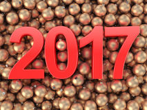 3D rendering 2017 New Year red digits. And gold christmas balls lying on a wooden surface Stock Photography