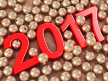 3D rendering 2017 New Year red digits. And gold christmas balls lying on a wooden surface Royalty Free Stock Image