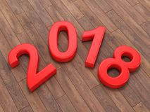 3D rendering 2018 New Year red digits. Lying on a wooden surface Stock Photography
