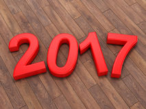3D rendering 2017 New Year red digits. Lying on a wooden surface Royalty Free Stock Photography