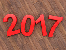 3D rendering 2017 New Year red digits. Lying on a wooden surface Royalty Free Stock Image