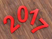 3D rendering 2017 New Year red digits. Lying on a wooden surface Stock Photography
